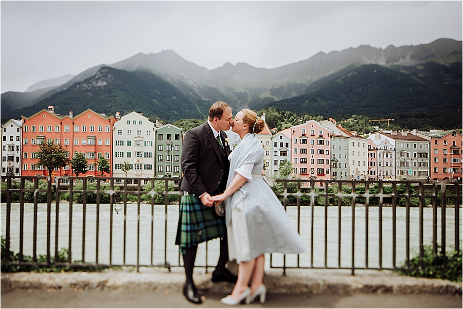 Groom in a kilt and bride in a dirndl at multicultural wedding in Innsbruck by Wild Connections Photography