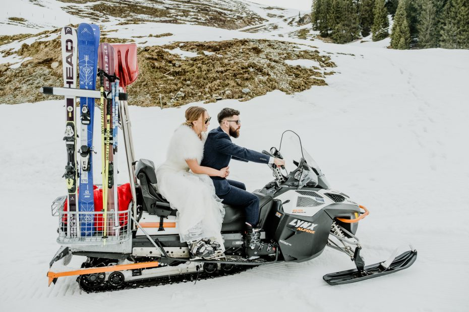 Bride and groom on a skidoo